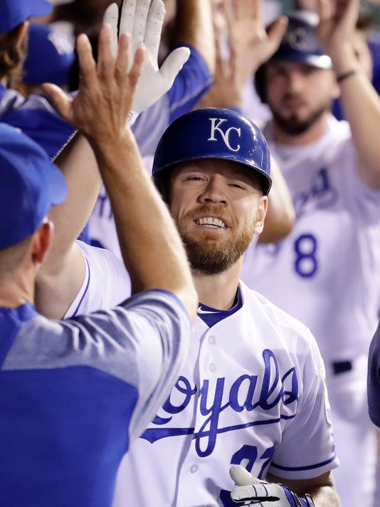 Kansas City Royals' Brandon Moss celebrates in the dugout after hitting a two-run home run during the fifth inning of a baseball game against the Seattle Mariners Thursday, Aug. 3, 2017, in Kansas City, Mo. (AP Photo/Charlie Riedel)
