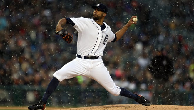 Snow falls as Tigers pitcher David Price throws in the first inning Wednesday at Comerica Park.