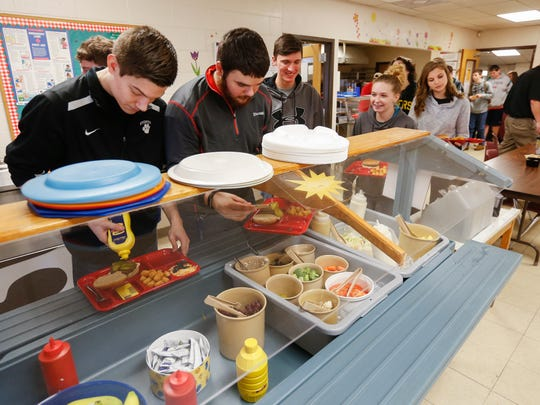 Everton students fill up their lunch trays in the school cafeteria on Tuesday, January 17, 2017.