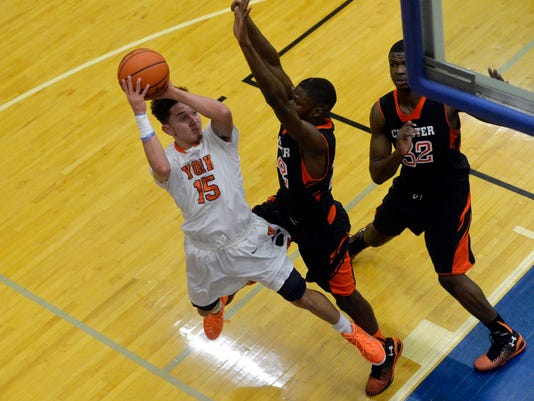William Penn's Trey Shifflett shoots the ball against Chester's Jamar Sudan and Maurice Henrey in the second half of a boys basketball game on Saturday, Dec. 20, 2014, at William Penn. Chester defeated William Penn 49-48. Chris Dunn Ñ Daily Record/Sunday News