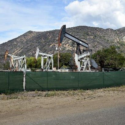 Oil wells tower above the Santa Paula Canyon trailhead