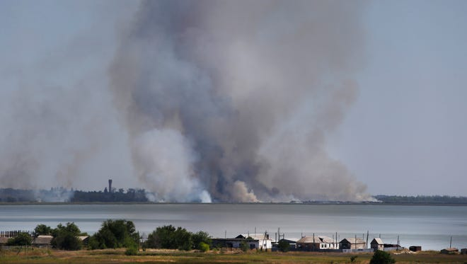 Smoke rises after shelling in the town of Novoazovsk, eastern Ukraine, on Aug. 26.