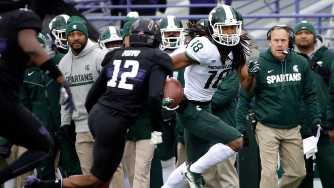 Michigan State wide receiver Felton Davis III, right, runs with the ball against Northwestern during the first half of an NCAA college football game in Evanston, Ill., Saturday, Oct. 28, 2017.