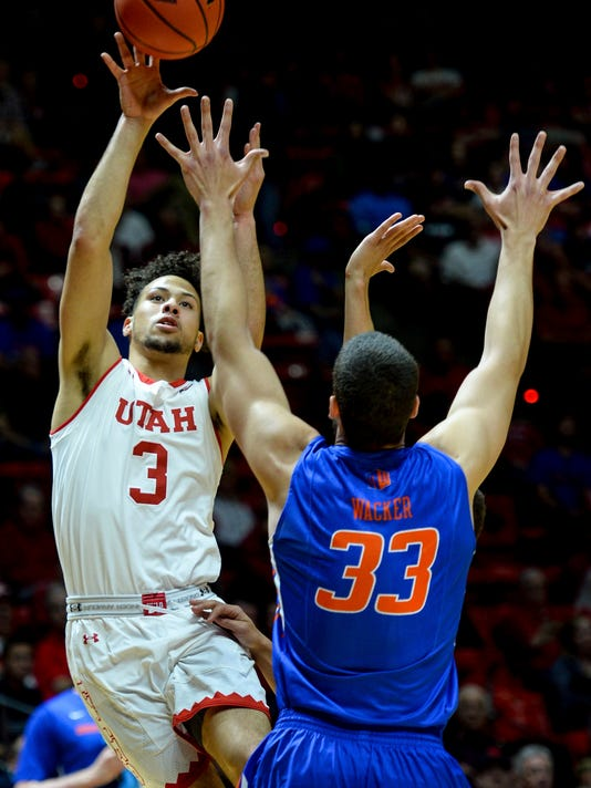 Utah guard Devon Daniels (3) shoots over Boise State forward David Wacker (33) in the first round of an NIT college basketball game in Salt Lake City on Tuesday, March 14, 2017. (Steve Griffin/The Salt Lake Tribune via AP)