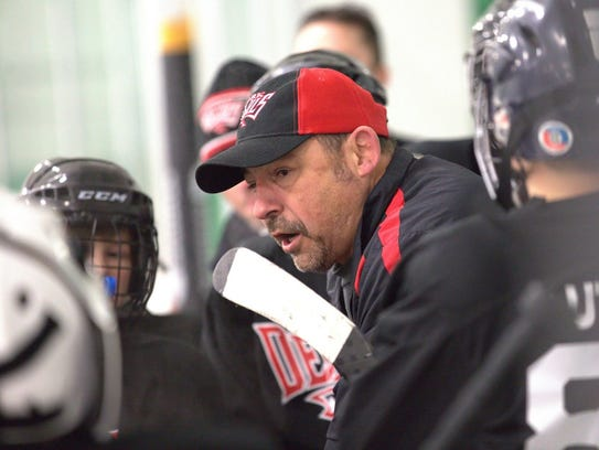 Steve Navaroli speaks to the youth ice hockey team