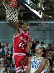 Ball State center Lonnie Jones, left, gets the bucket