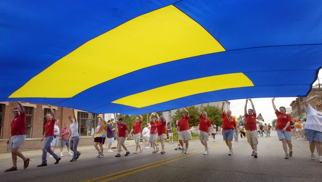 Supporters for The Human Right Campaign carry a large equal rights flag Jun3 11, 2005, in the IN Pride Day Parade on Massachusetts Avenue in downtown Indianapolis.