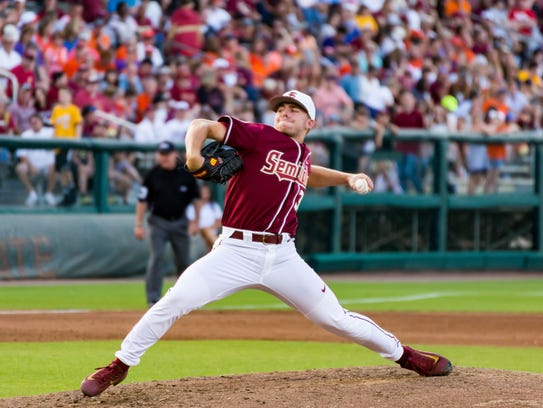 Florida State freshman pitcher Grant Stewart (32) delivers
