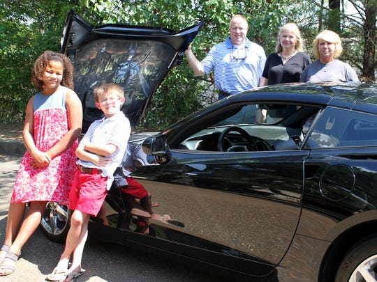 "Showing off the ""Bat Mobile"" Corvette are: from left, Camp Kandu Kids Arianna Turner, of Pearl; Caleb Warnock, of Brandon; Robert Dozier, of Madison, Diabetes Foundation Board of Directors; Irena McClain, of Ridgeland, DFM associate director; and owner of the ""Bat Mobile"" Rhonda Dombrowski of Brandon."