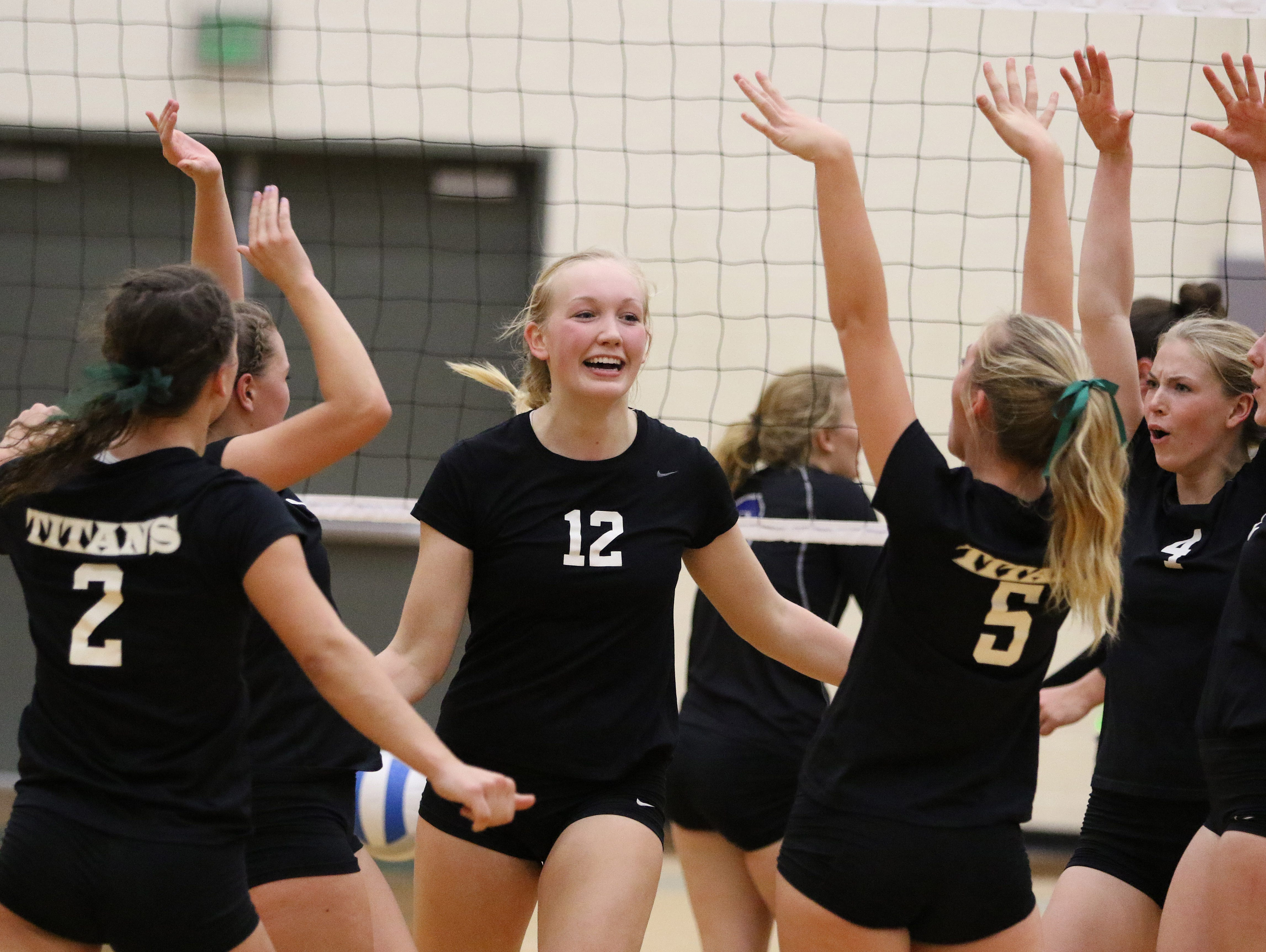 West Salem's Paige Whipple (No. 12) celebrates a point against McNary in the Greater Valley Conference finale Thursday, Oct. 22, 2015.