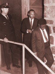 The Rev. Martin Luther King Jr. leaves the building