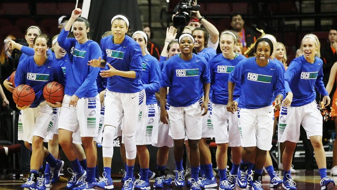 KINFAY MOROTI/THE NEWS-PRESS ... FGCU's Jtake the court to play Oklahoma State University on Saturday (3/21/15) in the NCAA Division I Women's Basketabll Championship first round game at the Donald L. Tucker Civic Center in Tallahhassee. FGCU beat OKU 75-67.