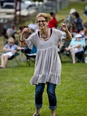 Denise Richard, of Mount Pleasant, dances to the music during the East Ports Blues Festival Saturday, Aug. 1, in Port Sanilac.