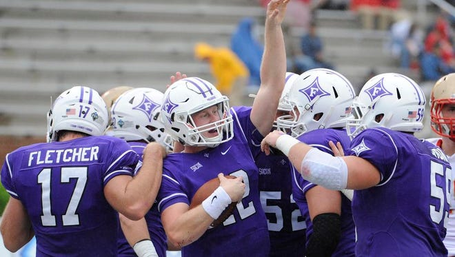 Furman quarterback Reese Hannon (12) and the Paladins host S.C. State on Saturday