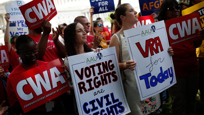 Activists attend a Voting Rights Amendment Act rally on Capitol Hill in June.