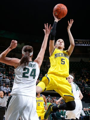 Michigan's Shannon Smith (5) goes to the basket against Michigan State's Lexi Gussert (24) during the first half Thursday.