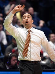 Texas head coach Shaka Smart yells instructions to his team during the second half of their first round game in the 2018 NCAA Division I Men's Basketball Championship at Bridgestone Arena Friday, March 16, 2018 in Nashville, Tenn.