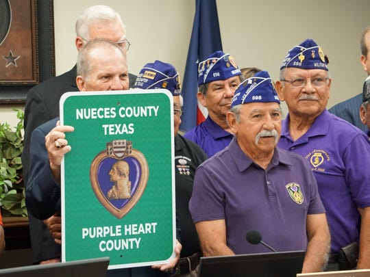 Local veterans gathered at the county courthouse on July 11, 2018 as commissioners designated Nueces County a Purple Heart County.