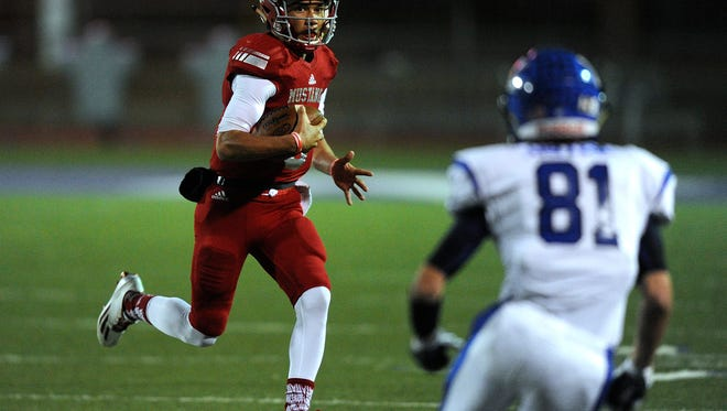 Sweetwater quarterback Chris Thompson (6) runs the ball during the first quarter of the Mustang's 40-14 win on Friday, Nov. 18, 2016, at Tarleton Memorial Stadium in Stephenville.