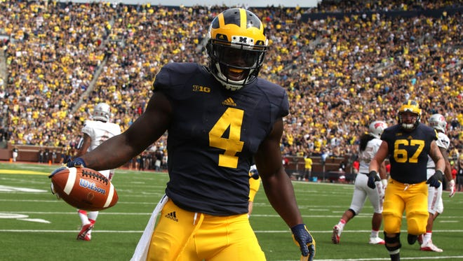 Michigan running back De'Veon Smith celebrates in the end zone after scoring Michigan's first touchdown Saturday.