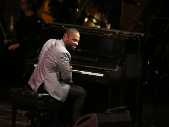 Michael Mitchell plays the piano for Leslie Odom Jr.'s performance with the Milwaukee Symphony Orchestra at the Marcus Center for the Performing Arts Friday.