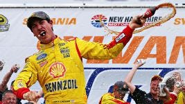 Joey Logano seen here after winning the Sylvania 301 NASCAR Sprint Cup race at NHMS in Loudon, NH. (Credit: Ap photo.)