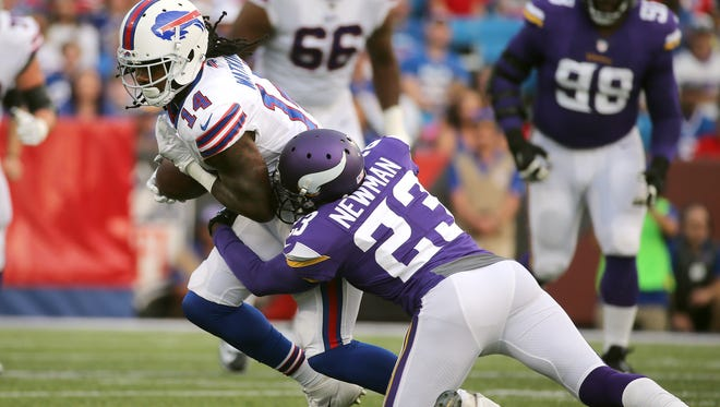 Sammy Watkins is tackled after a catch by Terence Newman.