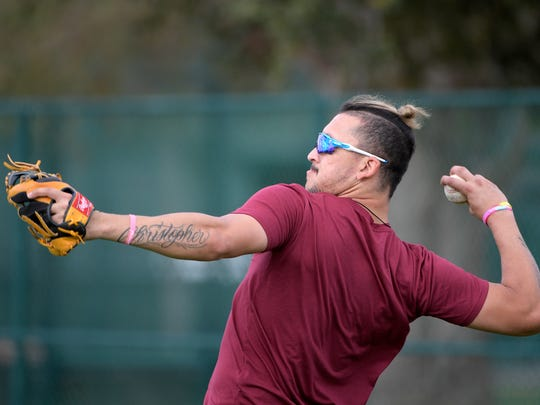 Hernan Perez throws while training at the Tom Shaw performance camp Monday, Jan. 22, 2018, in Lake Buena Vista, Fla.