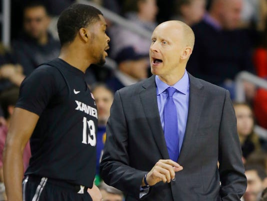 Xavier head coach Chris Mack has a word with forward Naji Marshall (13) as he comes off the floor during the first half of their NCAA college basketball game against Providence, Saturday, Jan. 6, 2018, in Providence, R.I. (AP Photo/Stephan Savoia)