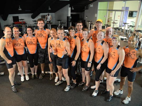 Members of the Beverly Hills Club triathlon team pose