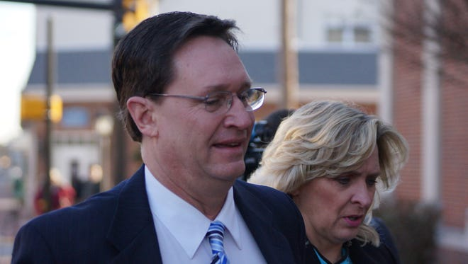 Eric Bodenweiser and his wife, Patty Bodenweiser, walk toward the Sussex County Courthouse in Georgetown on Wednesday.