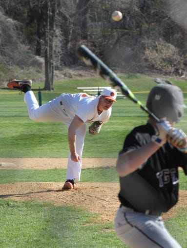 White Plains' Lukas Repetti (23) pitches during game action against Mamaroneck at White Plains High School on April 21, 2014.  Mamaroneck defeated White Plains 7-3.
