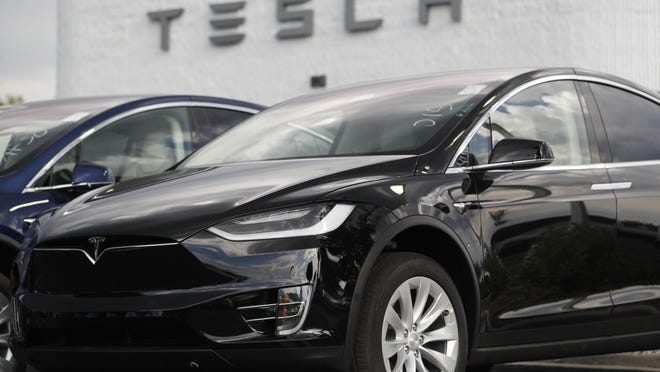 In this July 8, 2018 file photo, a 2018 Model X sits on display outside a Tesla showroom in Littleton, Colo.