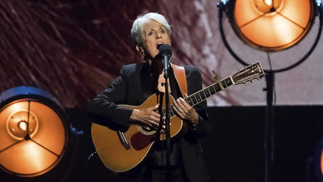 FILE - In this April 7, 2017 file photo, inductee Joan Baez performs at the 2017 Rock & Roll Hall of Fame induction ceremony at the Barclays Center in New York. Singer, songwriter, activist and Rock and Roll Hall of Fame member Baez is this year's recipient of the Woody Guthrie Prize, an award that recognizes artists who speak out for the less fortunate. Baez will be honored with a virtual ceremony on Aug. 16, 2020.