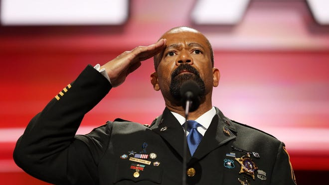 Milwaukee County Sheriff David A. Clarke Jr. salutes the crowd prior to delivering a speech on the first day of the Republican National Convention. Clarke received a large ovation Monday.