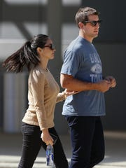 Green Bay Packers quarterback Aaron Rodgers and actress Olivia Munn walk to the set of a commercial being filmed outside of the Fox Valley Performing Arts Center in downtown Appleton in 2014.