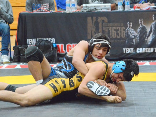 Carlsbad's Fabian Padilla grabs hold of Hobbs' Dante Sparenberg on Saturday, Jan. 28. Padilla, the 6A 138-pound state runner-up, has two more seasons left with the Cavemen.