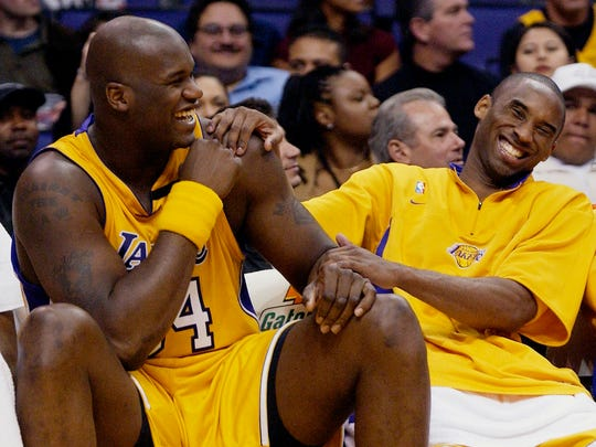 Los Angeles Lakers Shaquille O'Neal, left, and Kobe Bryant share a laugh on the bench in 2003.