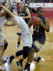 Zion Sanders of Central collides with Anna Newman of