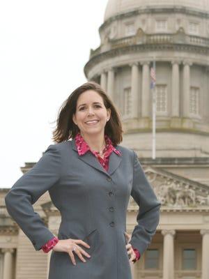 Kerri Richardson, Gov. Steve Beshear's spokesperson, stands in front of the Kentucky Capitol.