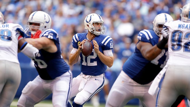 Indianapolis Colts quarterback Andrew Luck (12) drops back behind his offensive line in the first half of their game against the Detroit Lions Sunday, September 11, 2016, afternoon at Lucas Oil Stadium.