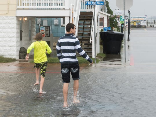 Two boys cross the street barefoot at the corner of Philadelphia Ave and Dorchester Street in Ocean City on Saturday.