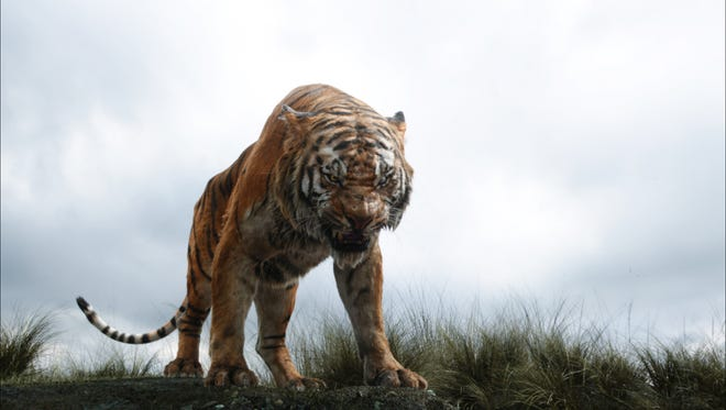 """In this image released by Disney, Shere Khan the tiger, voiced by Idris Elba, appears in a scene from, """"The Jungle Book."""""""