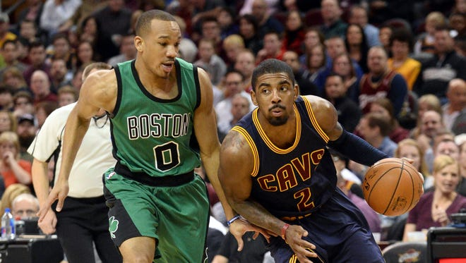 Cleveland Cavaliers guard Kyrie Irving drives past Boston Celtics guard Avery Bradley.