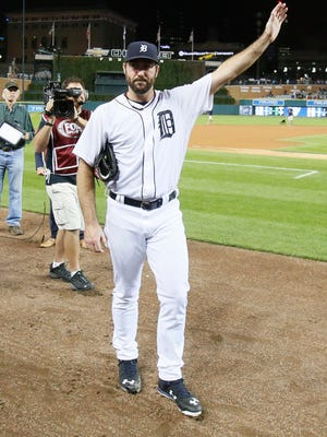 Tigers pitcher Justin Verlander waves to the crowd's applause as he leaves the field after his postgame interview after losing a no-hitter in the ninth inning of the Tigers' 5-0 win Wednesday at Comerica Park.
