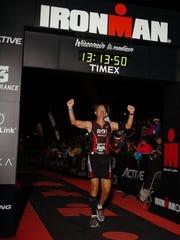 Robb Greenawald at the finish of the 2015 Ironman Madison triathalon.