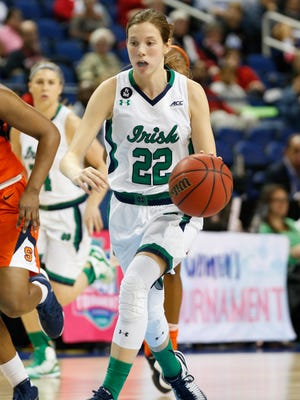 Notre Dame Fighting Irish guard Madison Cable (22) brings the ball up court against Syracuse during the women's ACC conference tournament at Greensboro Coliseum Complex. Notre Dame wins its third ACC championship with a score of 68-57 over Syracuse.