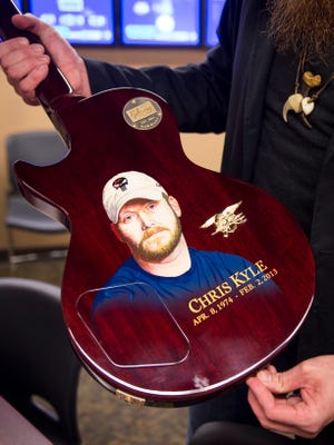 Nashville country artist Tim Montana holds a Gibson Les Paul custom made at the Gibson Custom Shop in Nashville to benefit the Chris Kyle Foundation.