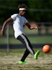 Team captain Nicholas Booker, 17, runs drills during practice at Pearl-Cohn High School in Nashville, Tenn., Tuesday, March 28, 2017.