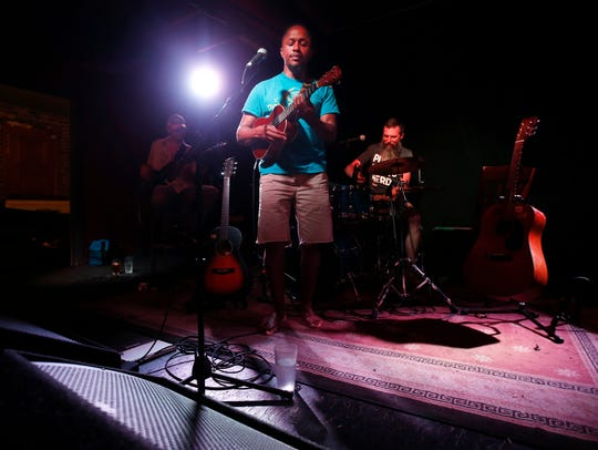 Patrick Mureithi performs at Patton Alley Pub in June.